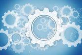 White wheels and cogs on blue — Stock Photo