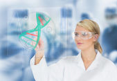 Doctor using touchscreen displaying DNA helix diagram — Stock Photo