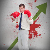 Businessman in boxing gloves against profit arrow and blood spatter — Stock Photo