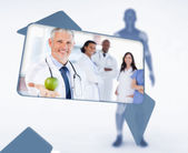 Screen displaying doctor holding apple in digital interface — Стоковое фото
