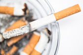 Close up of cigarette in ashtray — Stock Photo