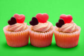 Three valentines cupcakes in a row — Stock Photo