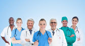 Medical team standing in line on blue background — Stock Photo