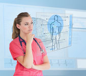 Nurse looking at a futuristic interface — Stock Photo