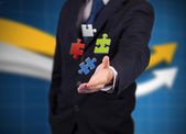 Businessman with digital puzzles — Stock Photo