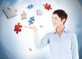 Well dressed woman with puzzles levitating — Stock Photo