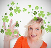 Blonde giving ok symbol for st patricks day and smiling — Stock Photo