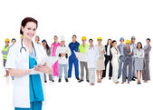 Pretty doctor standing in front of diverse career group — Foto Stock