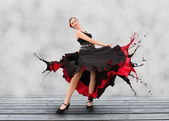 Flamenco dancer with dress turning to paint splashes — Stock Photo