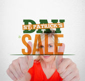 Bold text advertisement for st patricks day sale with smiling blonde — Stock Photo