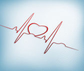 Red ECG line with heart graphic — Stock Photo