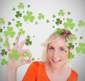 Blonde giving ok symbol for st patricks day — Stock Photo