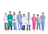 Happy medical team standing in line — Stock Photo