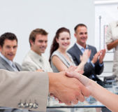 Businessman and woman shaking hands in presentation — Stock Photo