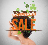 Text advertisement for st patricks day sale with girl looking into distance — Stock Photo