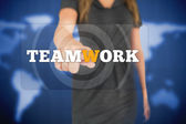 Businesswoman touching teamwork button — Stock Photo