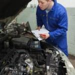 Car mechanic preparing checklist — Stock Photo #24091733