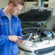 Male mechanic using digital tablet — Stock Photo
