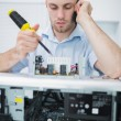Computer engineer working on cpu part while on call in front of — Stock Photo