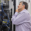 Technician searching for a solution in the server case — Stock Photo #24091793