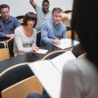 Smiling man asking question in lecture — Stock Photo