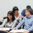 Students talking in lecture hall — Stock Photo #24092225