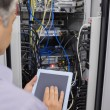 Stock Photo: Mdoing server maintenance with tablet pc