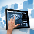 Hand touching digital tablet on digitally generated backgrou — Stock Photo #24092251