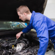Mechanic working under car bonnet — Stock Photo #24092279