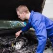 Mechanic working under car bonnet — Stock Photo