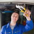 Mechanic repairing car with adjustable pliers — Stock Photo #24092383