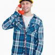Portrait of young male architect using landline phone — Stock Photo