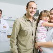 Smiling family and a pharmacist — Stock Photo