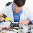 Close-up of computer engineer repairing sound card — Stock Photo #24092587