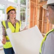 Woman and architect discussing blueprint — Stock Photo