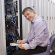 Stock Photo: Happy technicirepairing server
