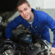 Stock Photo: Male mechanic repairing car