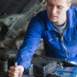 Mechanic working on car engine — Stock Photo #24092801