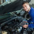 Auto mechanic by car with tablet pc — Stock Photo #24092813