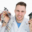 Portrait of young it professional yelling with cpu parts in hand — Stock Photo #24092827