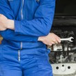 Mechanic leaning on car — Stock Photo