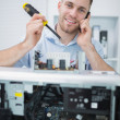 Computer engineer working on cpu part in front of open cpu — Stock Photo #24093119