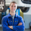 Confident male mechanic smiling — Stock Photo