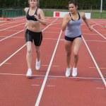 Women running a race — Stock Photo #24093413