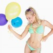 Cheerful woman holding balloons — Stock Photo #24093453