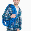 Portrait of smiling male architect carrying coiled blue tubing — Stock Photo #24093459