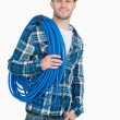 Stock Photo: Portrait of smiling male architect carrying coiled blue tubing