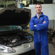 Stock Photo: Happy mechanic by breakdown car