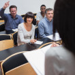 Man asking question in lecture — Stock Photo