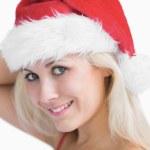 Beautiful woman wearing santa hat — Stock Photo #24093719